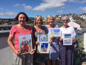 Four members of Teignmouth Art Group with their designs